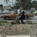 Tony Rome saving Rudy Kosterman from a drive by shooting at his construction site.