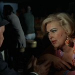 Tony Rome talks with Fat Candy as played by Joan Shawlee.